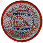 EACC silver embroidered badge